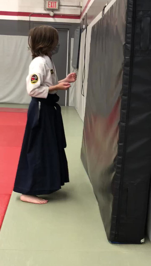 One of our advanced students in our Kids Program working on a basic self-defense technique