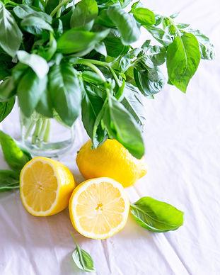 sliced-lemon-and-basil-leaves-on-glass-1