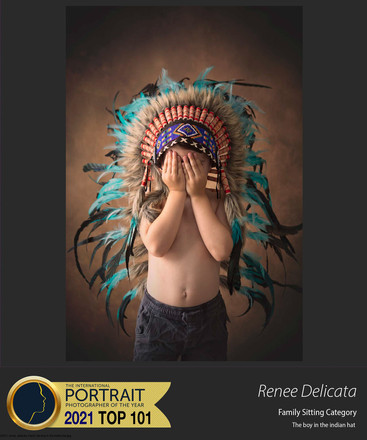 25917_renee_delicata_Famil_the boy in the indian hat.jpg