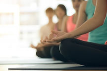 young-women-yoga-indoors-keep-calm-medit