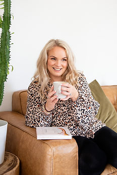 Kimberley Bartlett sitting on the couch