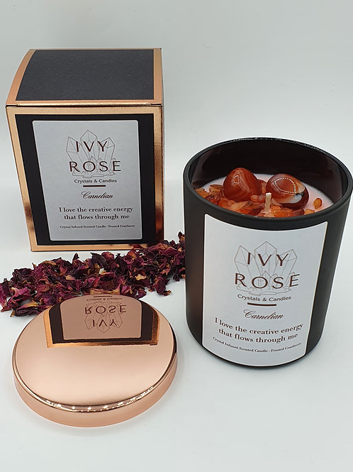 Carnelian crystal candle in black jar with rose gold lid