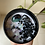 Virgo crystal candle with rainbow fluorite and snowflake obsidian aerial shot