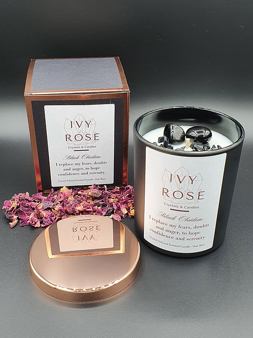 Crystal infused black obsidian candle in black jar with rose gold lid