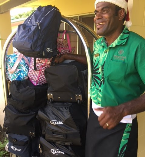 Me and Fiji travel blog | Friendly porter at Tokatoka Resort | expat in Fiji | Too much luggage