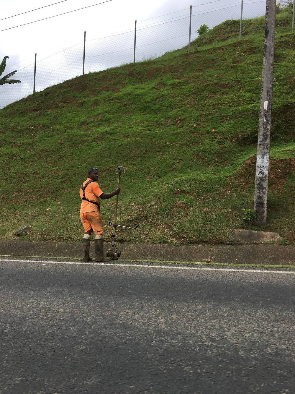 Me and Fiji | Prisoner gardening Outside the prison in Suva |