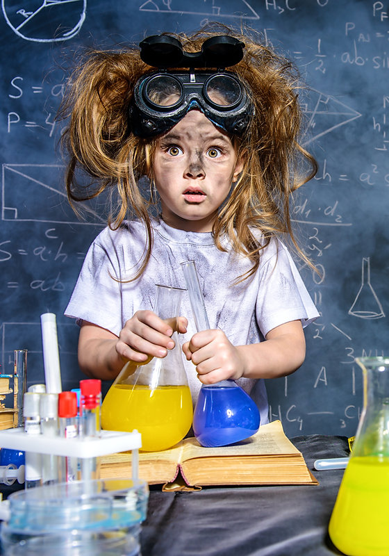 Funny little girl doing experiments in t