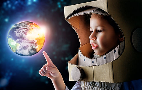 child is dressed in an astronaut costume.jpg