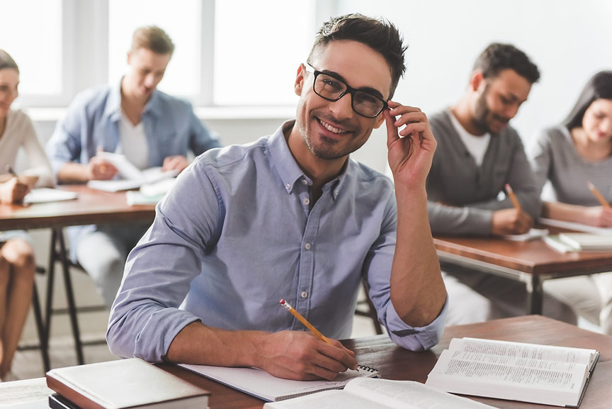 guy-smiling-while-making-notes-scaled.jpg