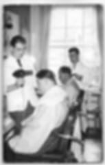 Derek Newman blowdrying a gentleman's hair in late 1950's