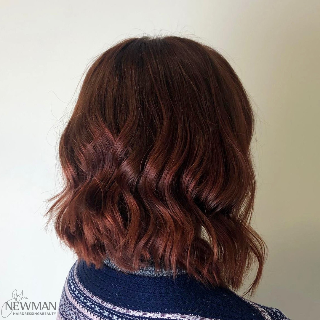 Glossy red hair finished with a wave