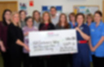 The John Newman Hairdressing & Beauty Team presenting a cheque to Kettering General Hospital