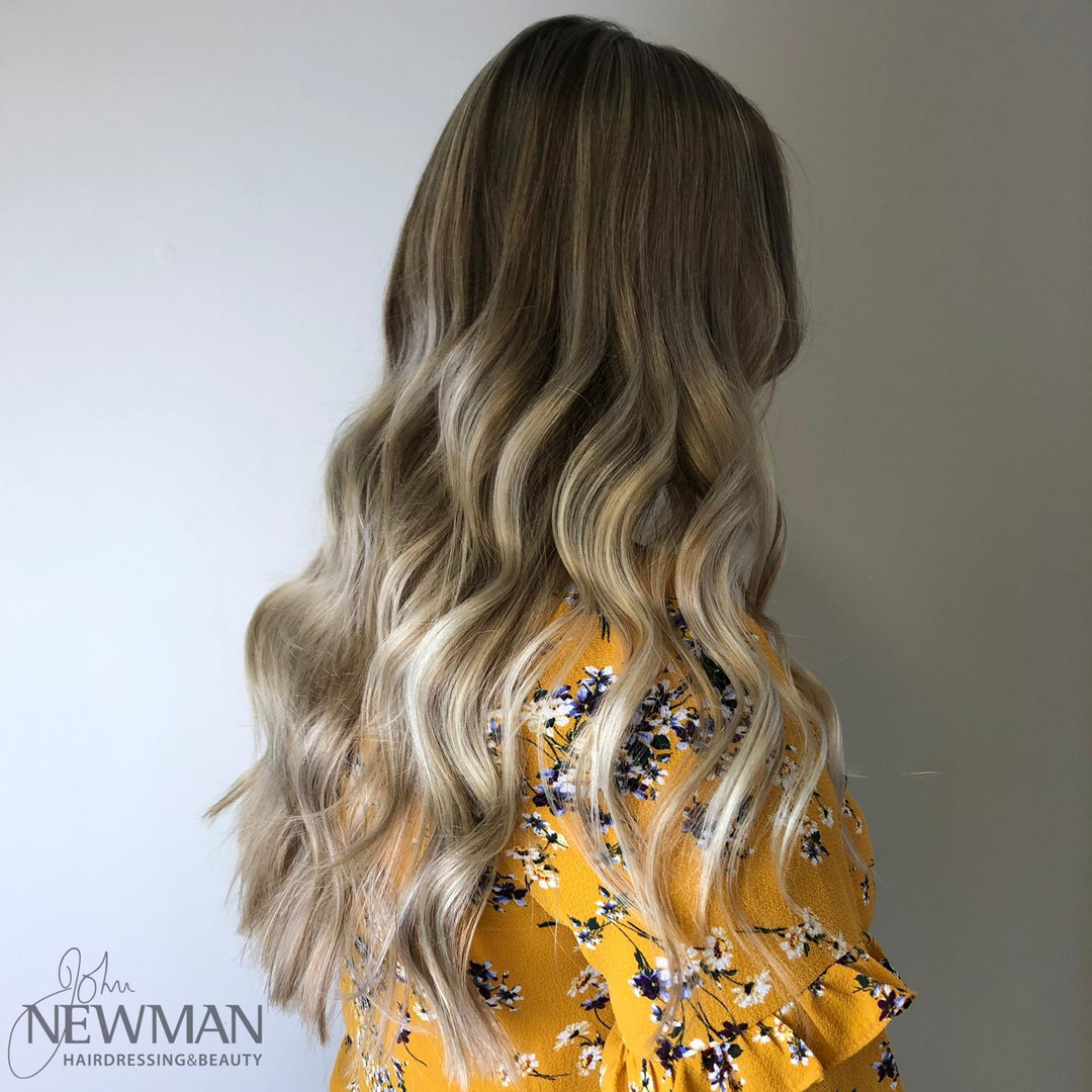 Long blonde balayage finished with a wave