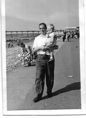 John Newman with his father Derek Newman, black and white photo at the seaside