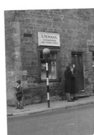 E. Newman Hairdressers & Tobacconists at No. 1 High Street, Rothwell