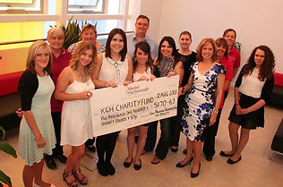 The John Newman Hairdressin & Beauty Team presenting the cheque to Kettering General Hospital