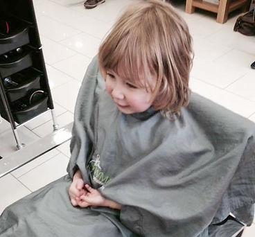 A young girl has her hair cut at John Newman Hairdressing & Beauty