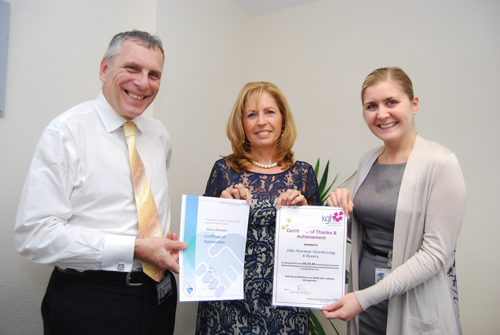 Shirley receiving a 'Certificate of Appreciation' from chairman of KGH, Graham Foster & 'Certificate of Thanks & Achievement' from Christina Kelly, fundraising officier at KGH. Shirley accepts these certifcates on behalf of everyone, especially the team at JNH&B.