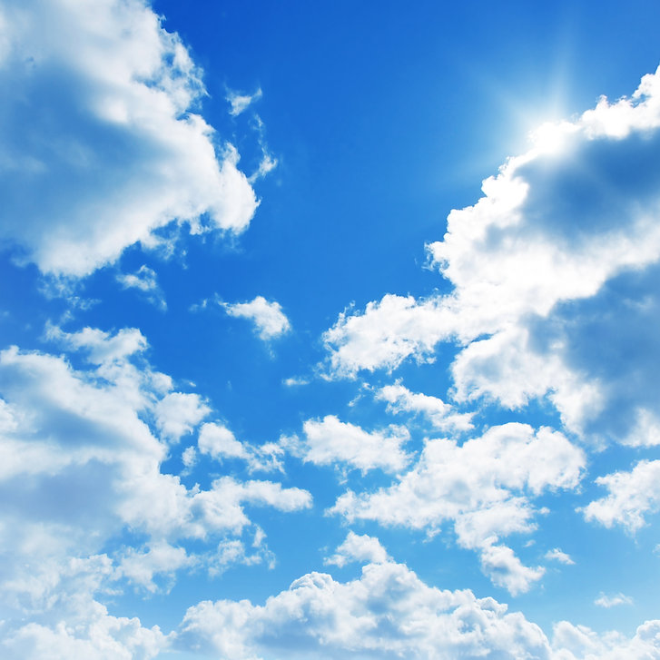 Blue sky with clouds and sun..jpg