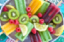Colorful popsicles with fresh fruits.jpg