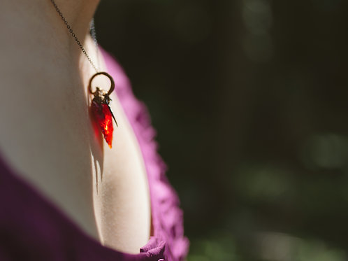 Garnet Glass Arrowhead with Feather Pendant