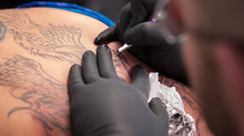 Tattoos hurt. Here's what you can do to make them hurt LESS.