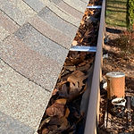 Greensboro gutter cleaning company. This image shows a clogged gutter that needs cleaning.