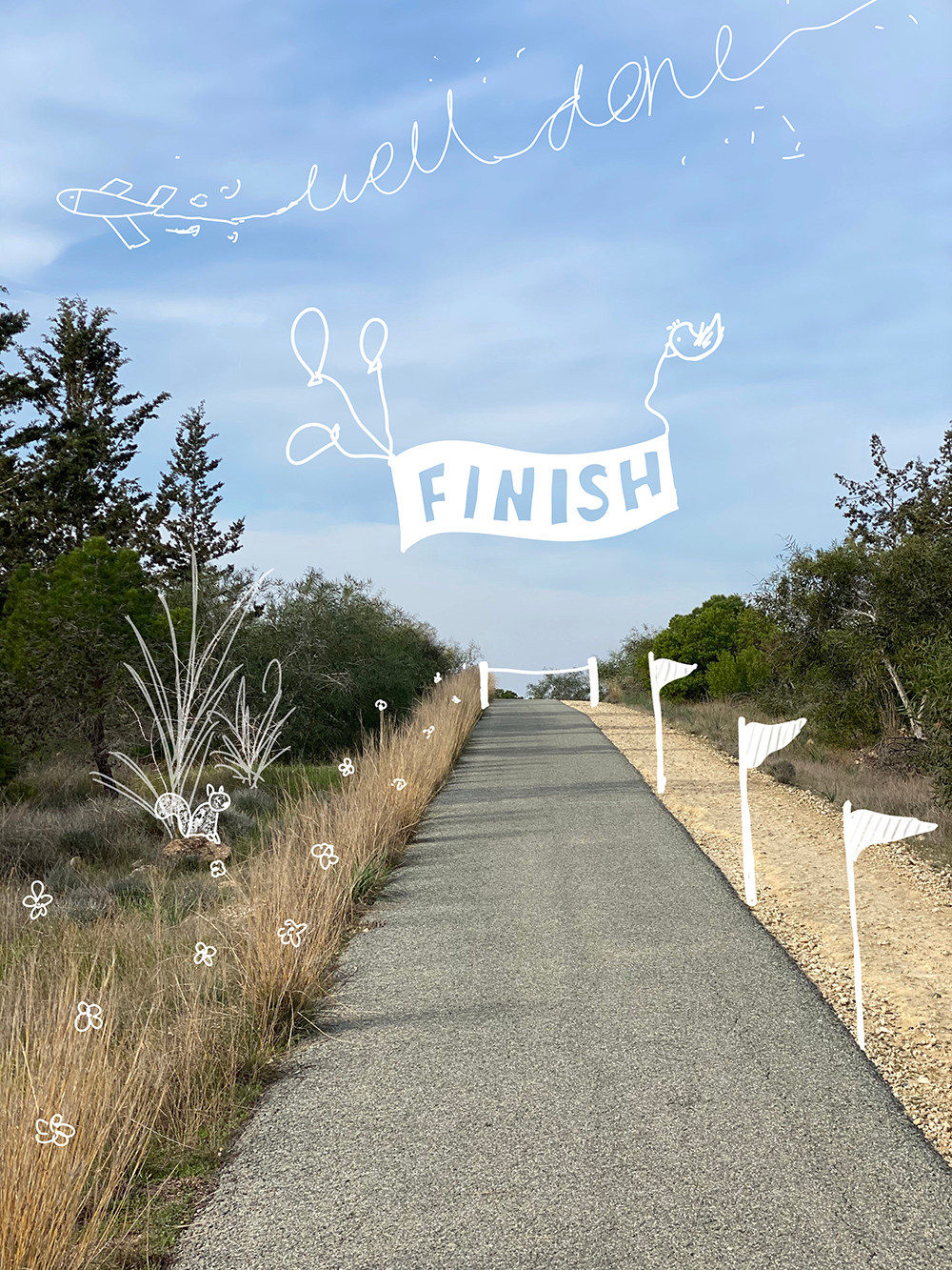 A photo of an uphill path. Doodles are drawn to make it look like the finish line of a competition.