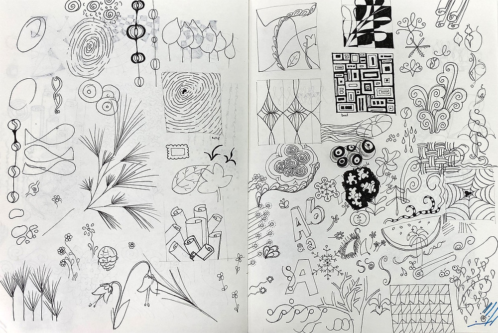 doodles and little drawings done in black ink in a sketchbook.