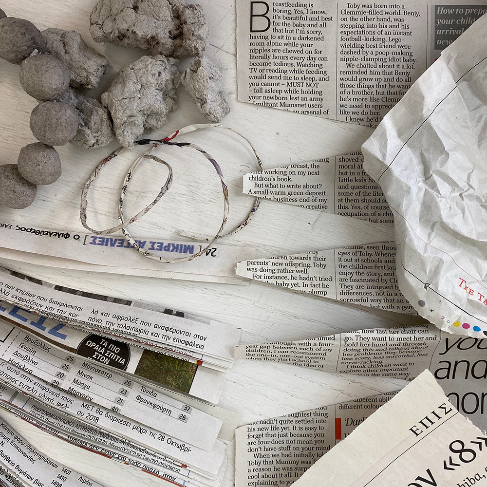 newspaper cuttings, newspaper string, newspaper pulp. Paper manipulations and experiments.