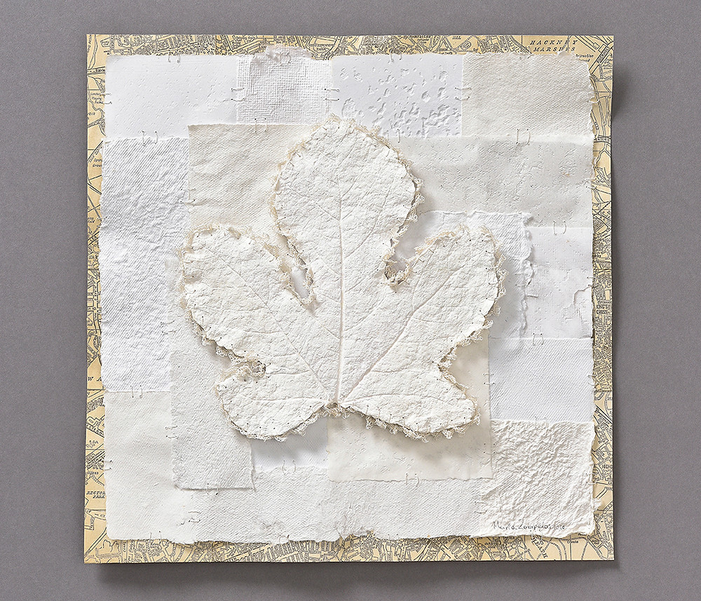White handmade paper art. It incorporates a paper leaf casting