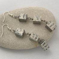 Dangling newspaper earrings