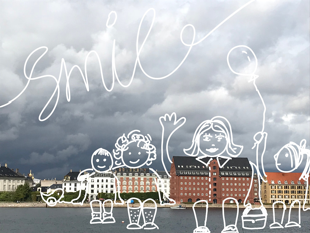 A photo of a row of buildings along a river is transformed into a whimsical scene by adding doodles. A family photo.