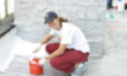 Image of Kim Moscaritolo painting a roof