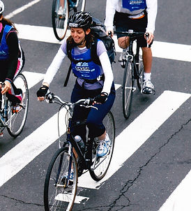 Image of Kim Moscaritolo riding a bike during the 5 Boro Bike Tour
