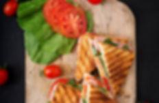 Club sandwich panini with ham, tomato, c