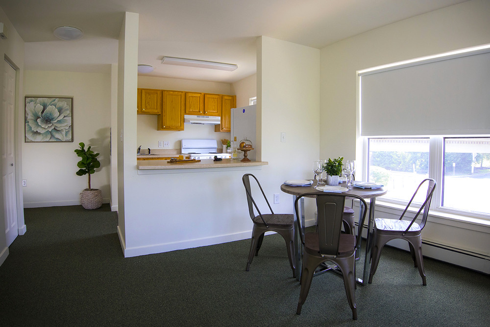 Typical One Bedroom Apartment at Ridge Oak II dining room looking into the kitchen