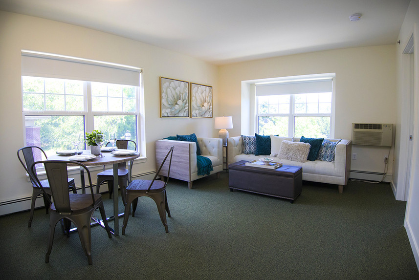 Typical One Bedroom Apartment at Ridge Oak II living room and dining room
