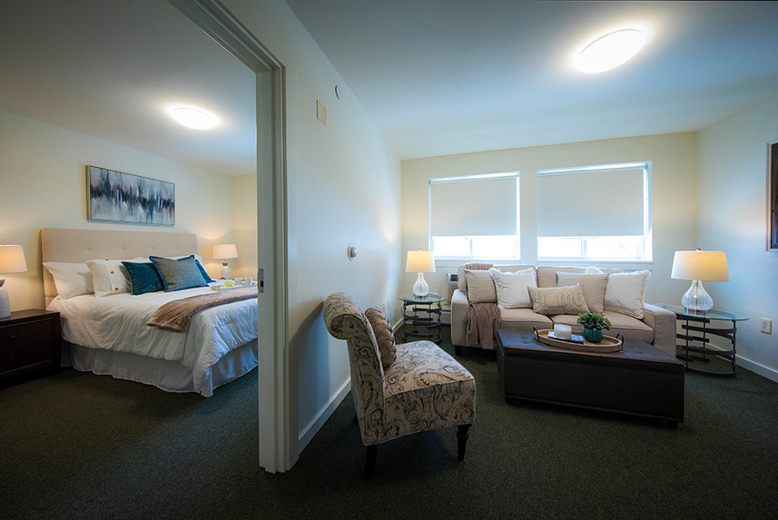 Bedroom and living room of a typical one bedroom apartment at Ridge Oak III