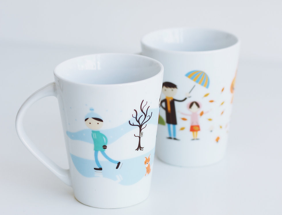 A pair of vintage kids mugs with illustrations