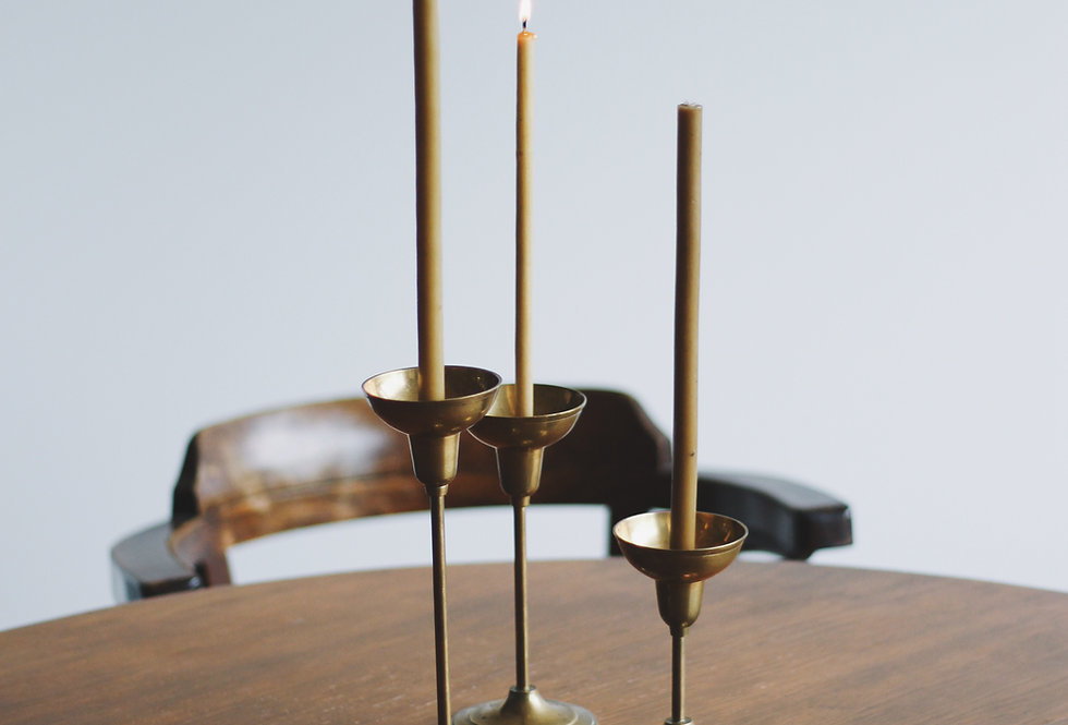 BRASS CANDLE HOLDERS A SET OF THREE