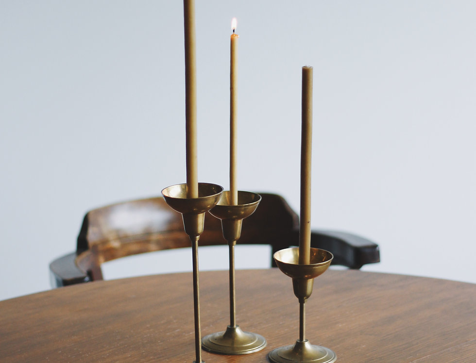 Brass candle holders set of three