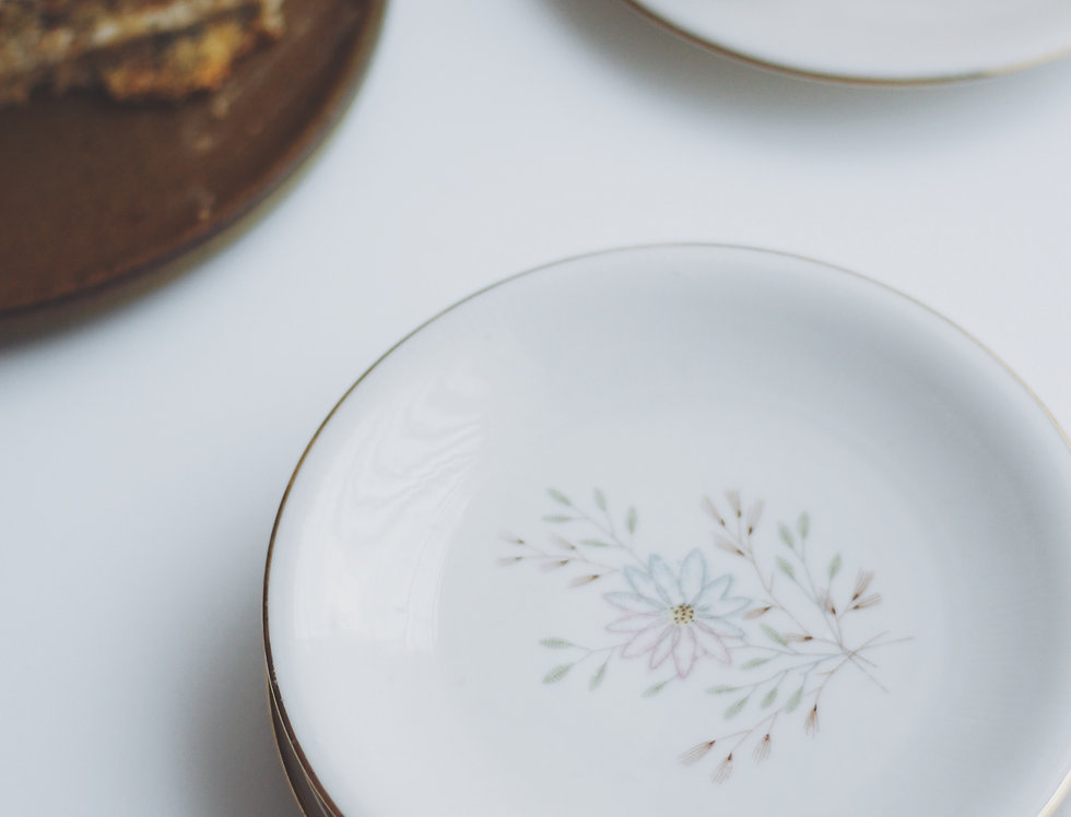 Vintage porcelain desert plates with soft toned flowers and gold edges set of 5