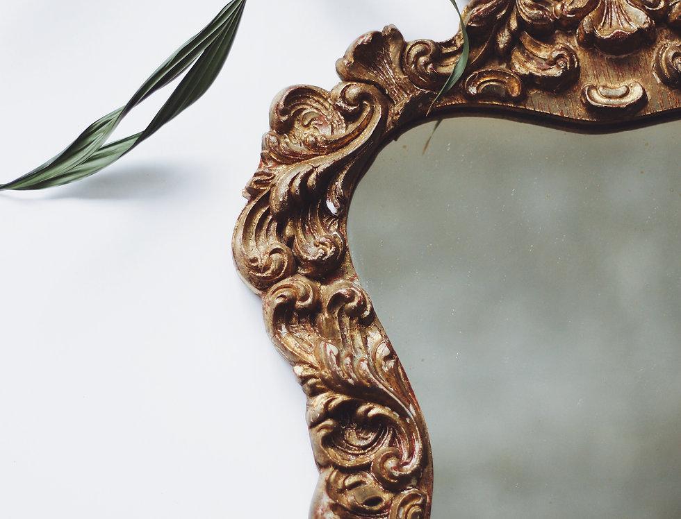 Vintage ornamented mirror frame
