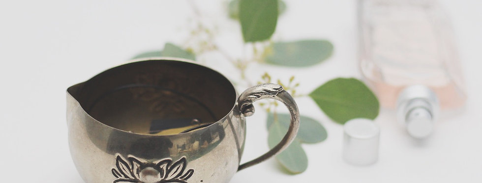 Vintage tin cup with a flower