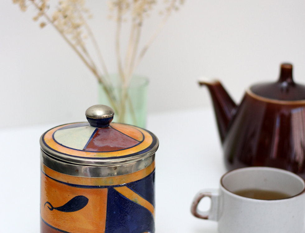 Vintage ceramic jar with metallic details and a lid