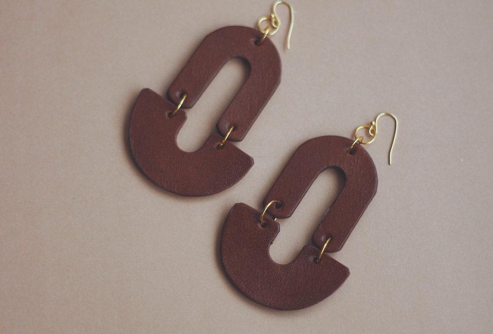 Oversize half moon leather earrings in ginger