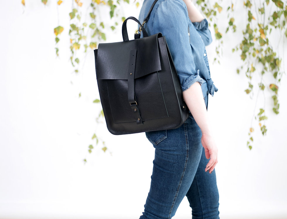 Iris backpack in black with strap closing
