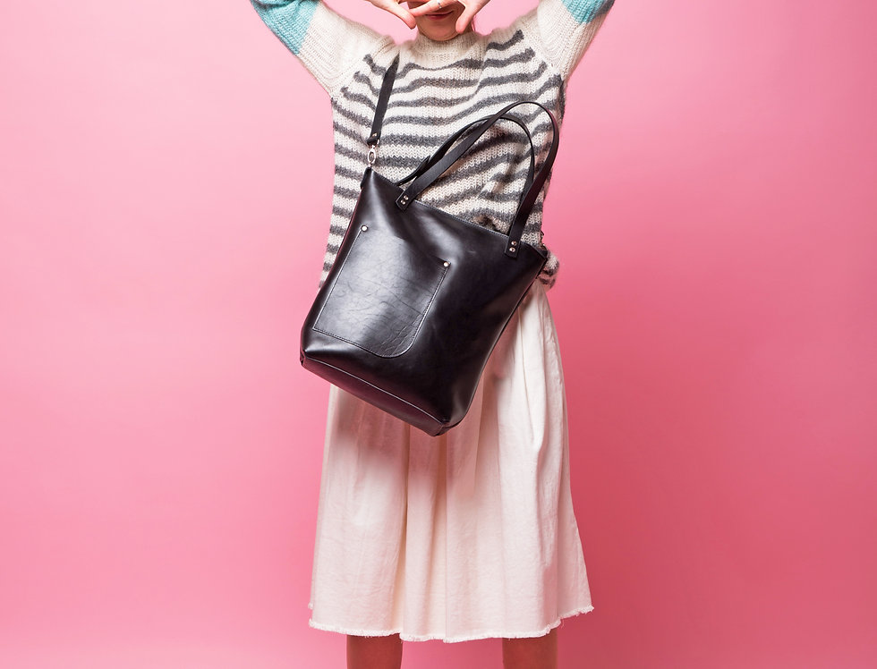 Black leather handbag with a side pocket with additional long strap