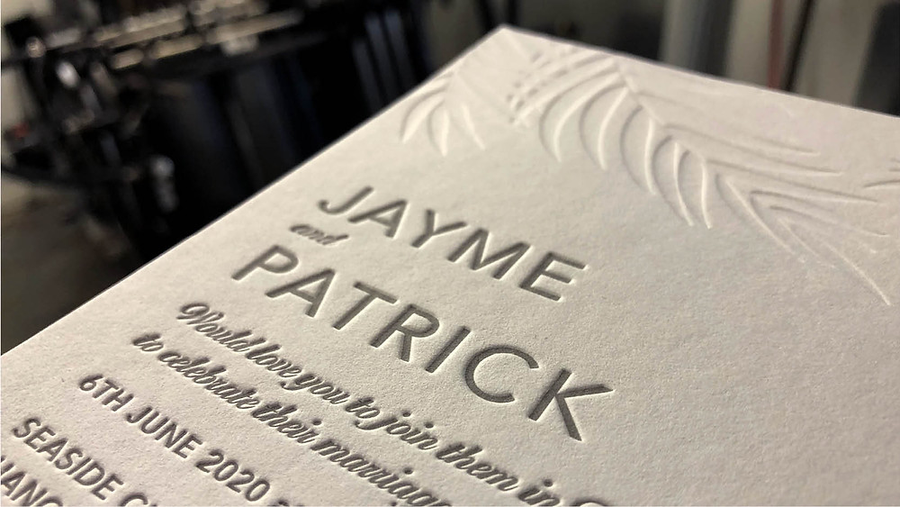 Photo of a wedding invitation for Jayme and Patrick